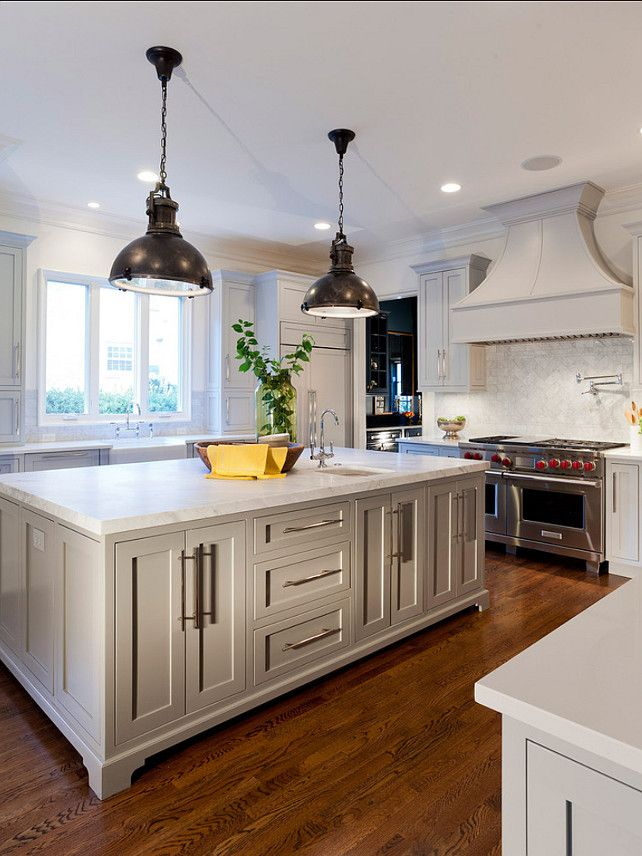 Oversized Kitchen Island With Built In Cabinet Storage And Pendant Light Hardwood Floors And Drama Grey Painted Kitchen Grey Kitchen Island Wood Floor Kitchen