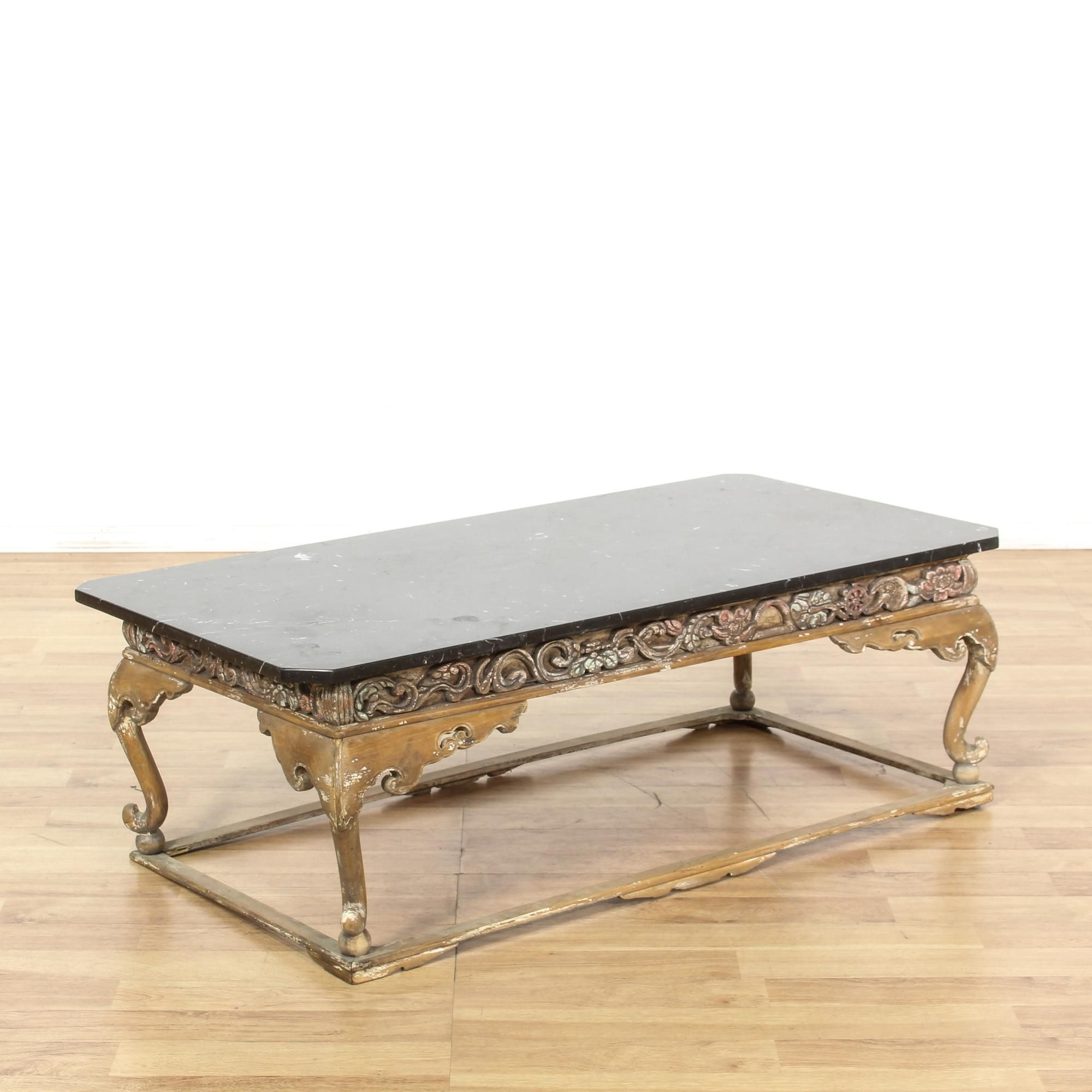 This Chinese coffee table is featured in a solid wood with