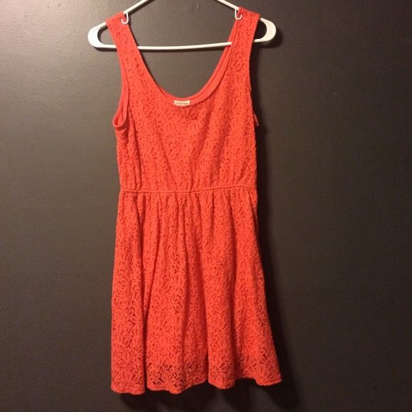 Orange Lace Dress Super cute and summery orange lace mini tank dress. about fingertip length. Fitted at the bust and then flares out just a little. A little bit stretchy in the middle with a side zipper. Modest scoop neck. Bought at target for about $25, will be selling for $12. Size large :) Mossimo Supply Co Dresses Mini
