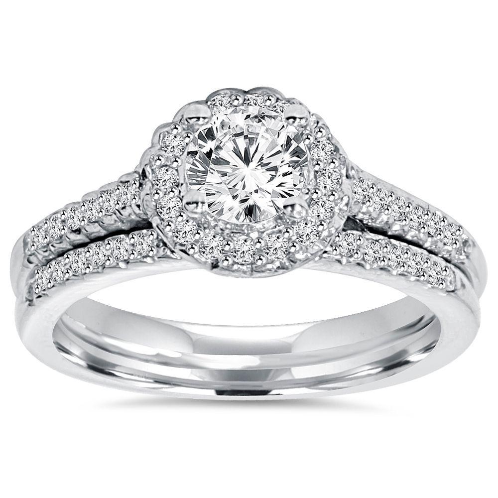 "<li>Diamond engagement ring</li><li>14k white gold jewelry</li><li><a href=""http://www.overstock.com/downloads/pdf/2010_RingSizing.pdf""><span class=""links"">Click here for ring sizing guide</span></a></li>"