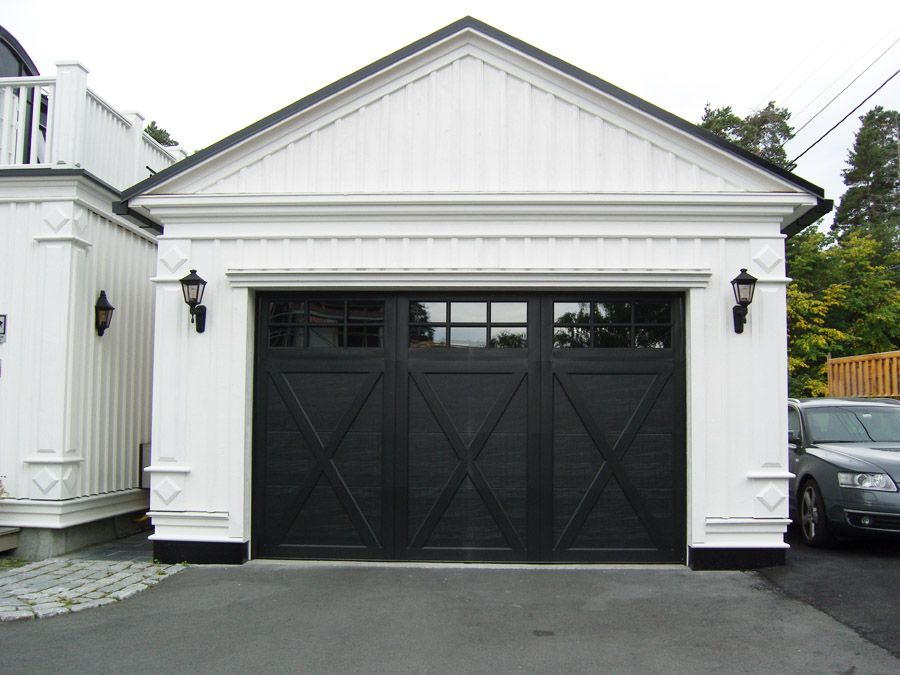 White garage with black x detail doors household pinte for What room has no doors or windows