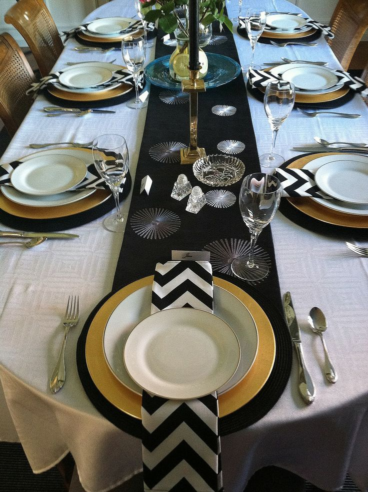 color scheme black white and gold? love the black runner with white linens and gold rimmed plates. Could do white feather centerpieces with this look. & table color scheme... runner can be gold! | Bridal Shower ...