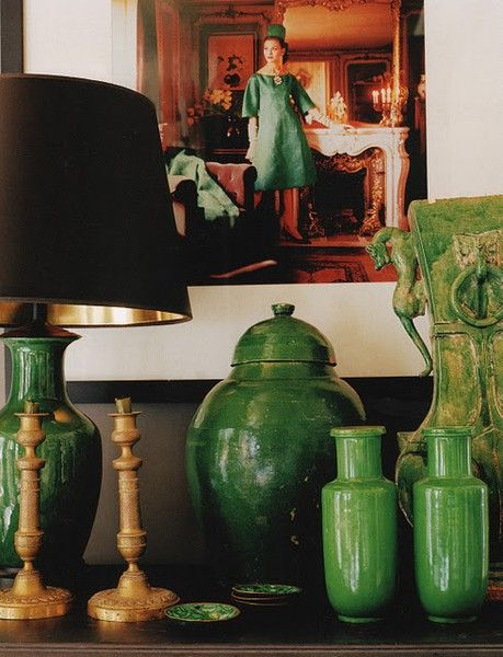 Collection of glazed green pottery, note that the vase on the left was made into a lamp, another way to highlight (literally) a collection.....k.....design Mary Mcdonald