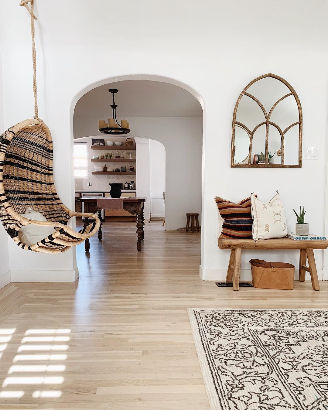 We love this striped hanging swing and patterned rug in this boho