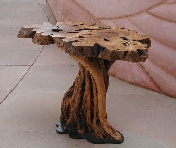 This table is made of branches pruned from an ancient olive