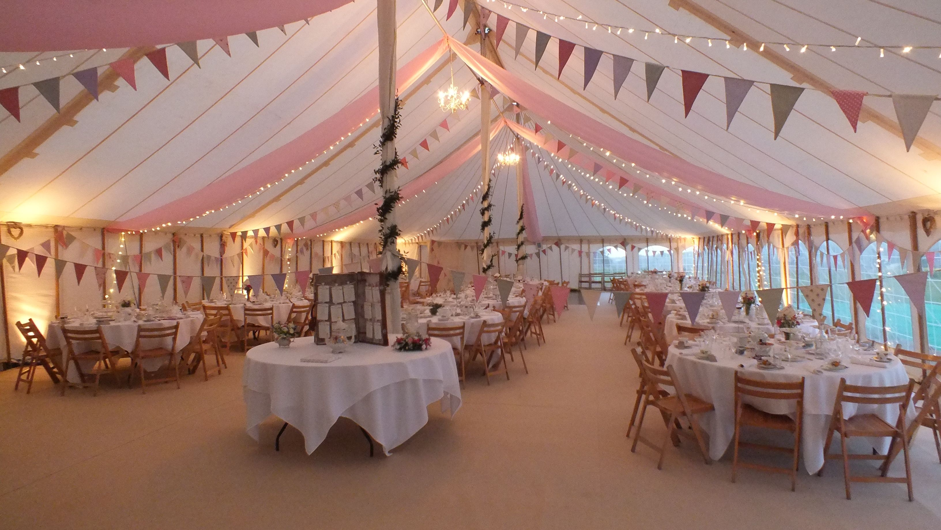 Wedding marquee decoration ideas  Fairy lights and bunting add a certain sparkle to your wedding day