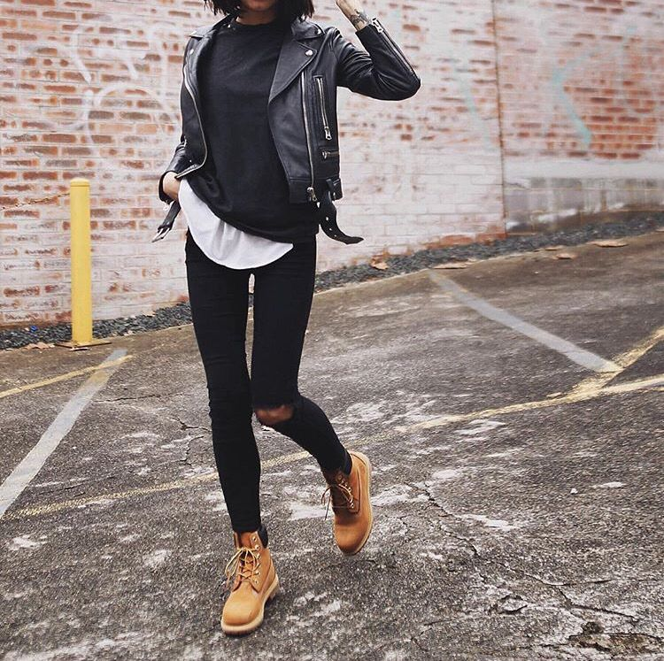 She pairs this look with distressed black jeans and Timberland boots for ...
