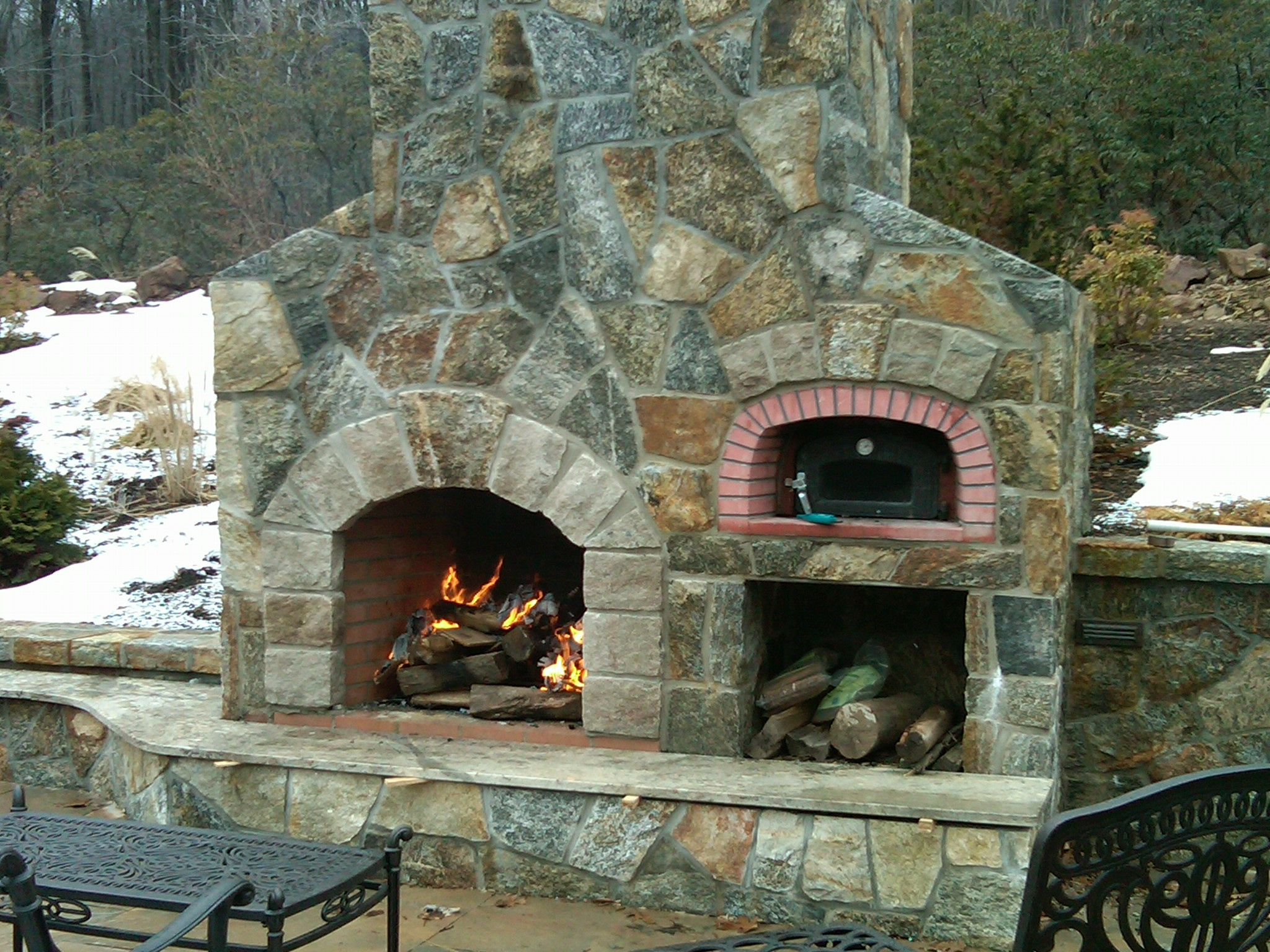 outdoor stone fireplace with pizza oven - what is the best interior