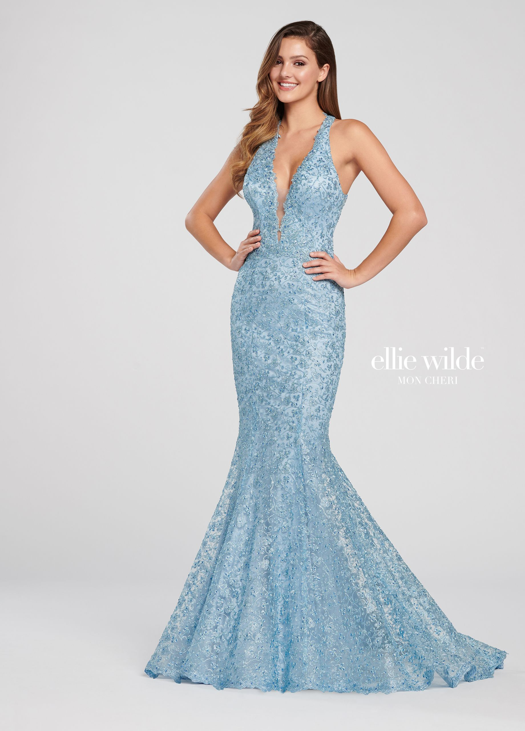 a2b52130e62ea Ellie Wilde EW119096 - This seductive sleeveless metallic lace trumpet  halter gown features an extreme plunge V-neck with an illusion panel, ...