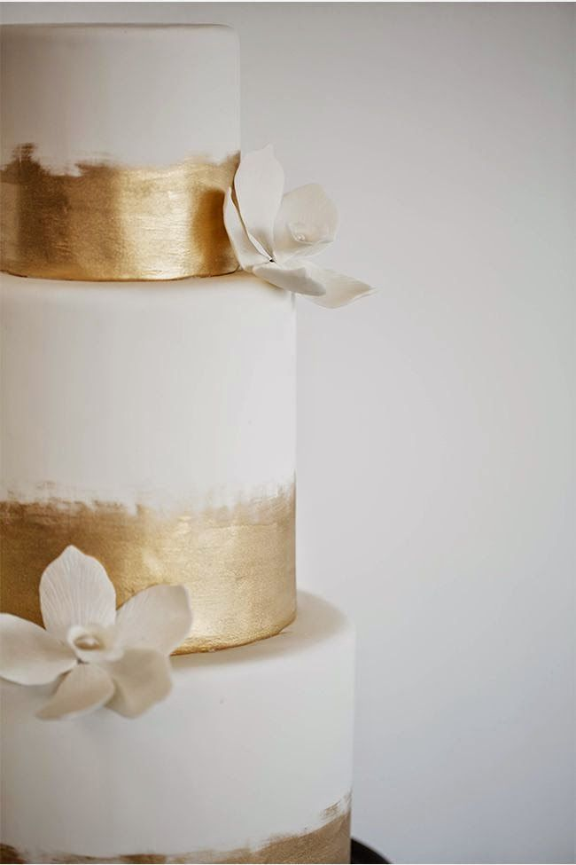 Clean and simple gold-accented wedding cake. Featured on Lily The Wandering Gypsy blog.