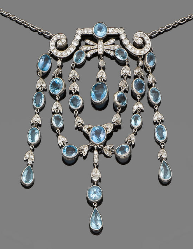 An aquamarine and diamond necklace @}-,-;--