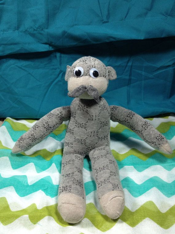Sock monkey with  mustache. Made by my lovely Mama
