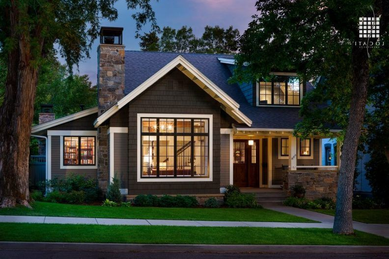 Craftsman house exteriors single brown front door along gray tile roof exterior paint colors for homes red brick exterior wall grey stone porch rail white