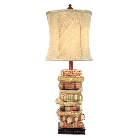 Table lamp with cushion-inspired accents and an hourglass shade.  Product: Table lampConstruction Material: Meta...