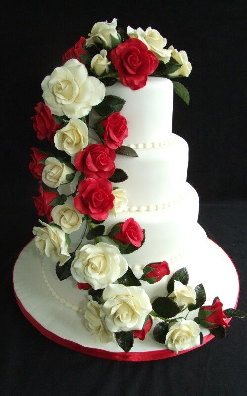 Wedding cake with cascading red & white roses