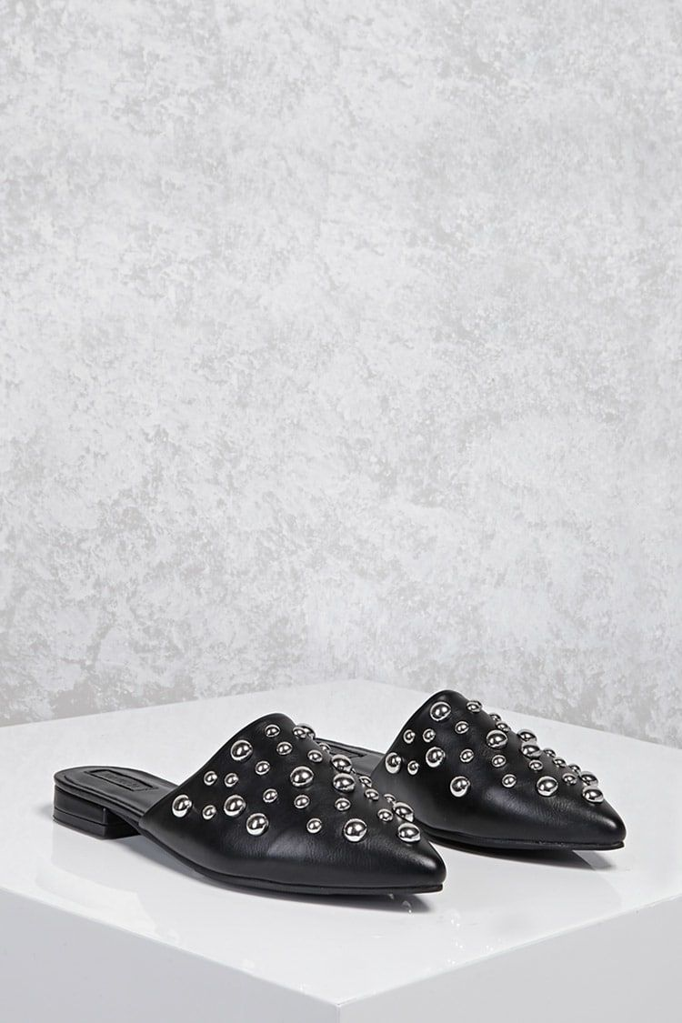A pair of faux leather flat mules featuring a bubble studded upper design,  slip-