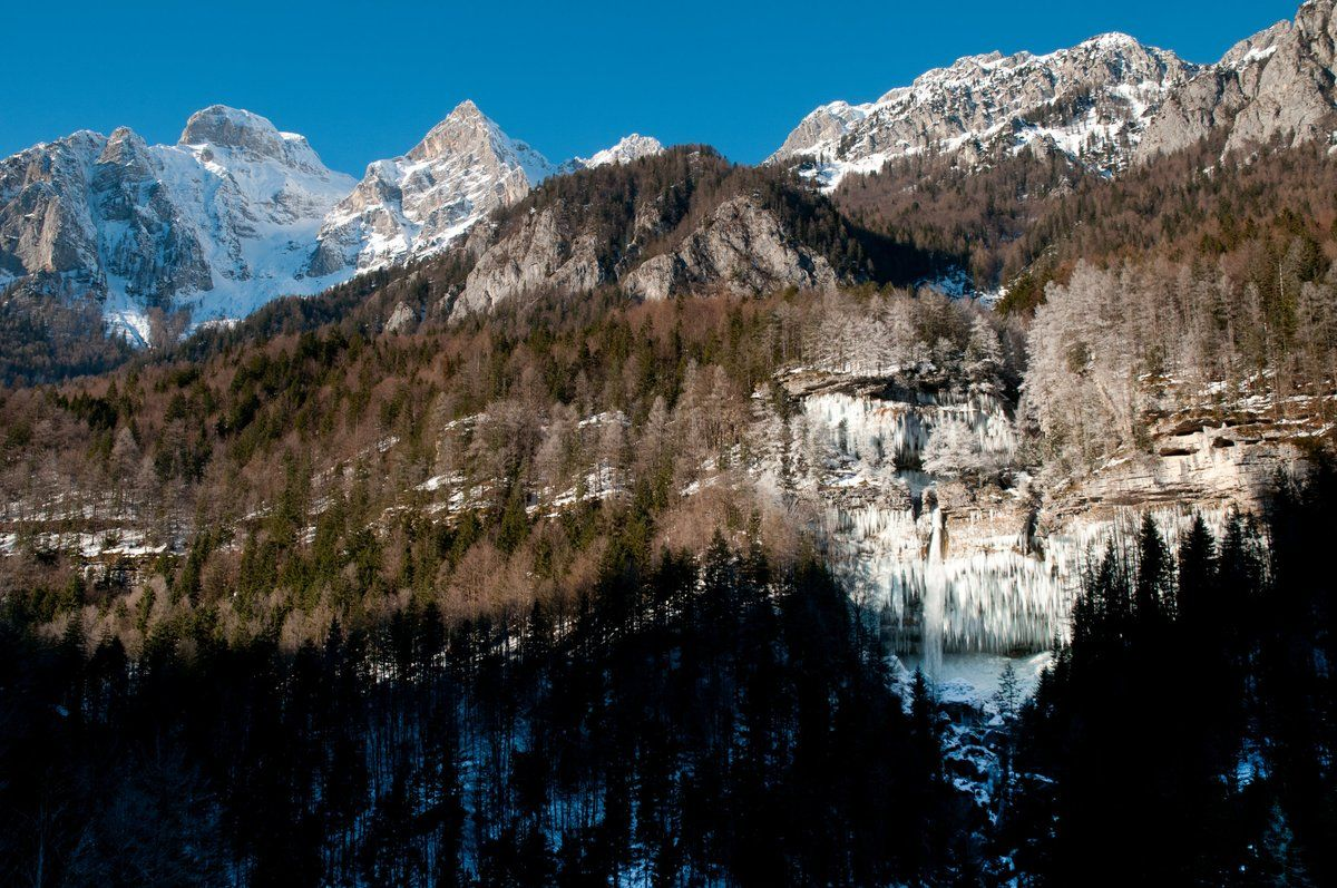 PERICNIK FALLS, #Slovenia - the most amazing sight of it is in winter when it turns into a giant wall of icicles and floes. Photo: Ales Zdesar