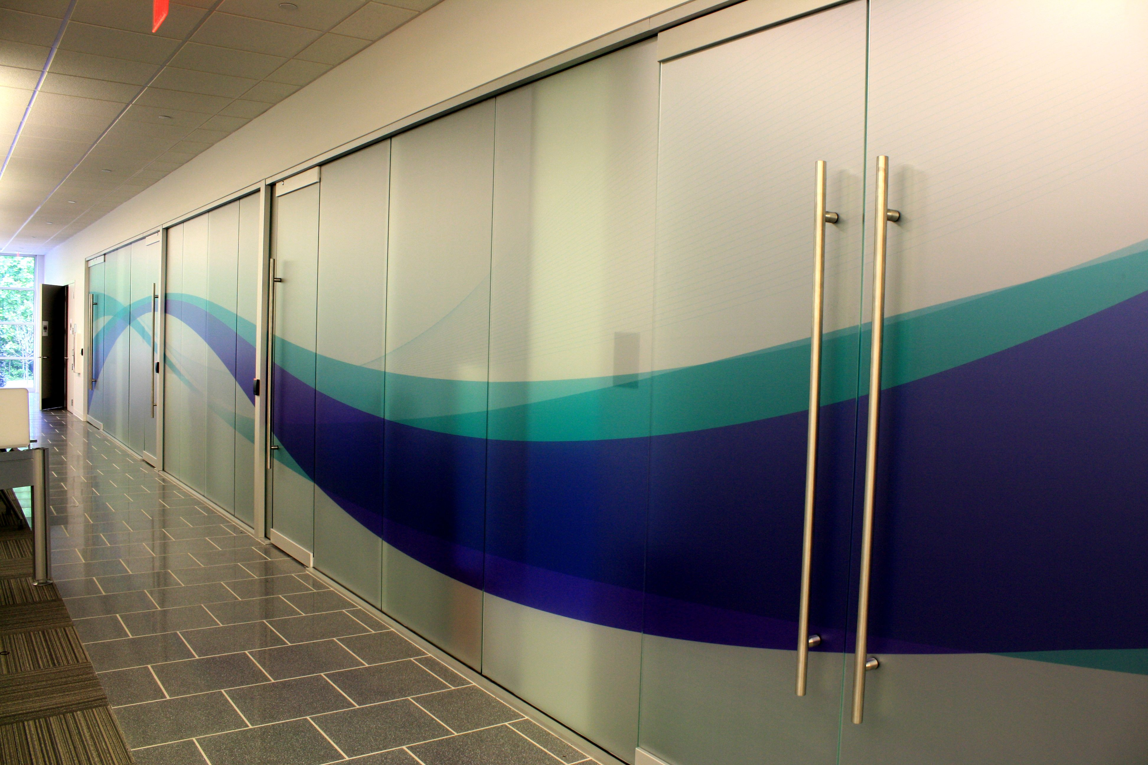 Frosted windows with a swoosh office branding office wall graphics floor graphics window graphics