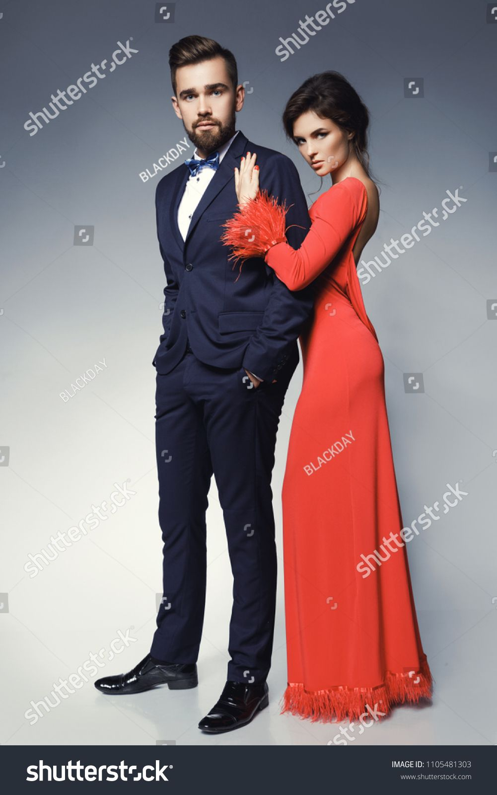 Attractive And Well Dressed Couple Posing In Studio Woman In Beautiful Red Dress And Man Wearing Blue Classical Suit Beautiful Red Dresses Women Couple Posing [ 1600 x 1001 Pixel ]