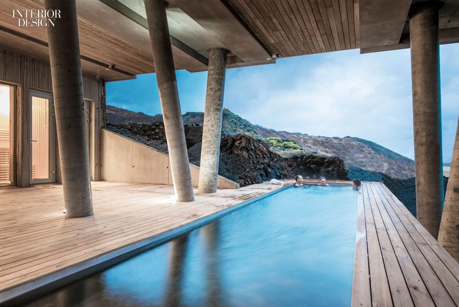 Imagine relaxing in the mountainside pool at Minarc's Ion Luxury Adventure Hotel in Nesjavellir, Iceland. For luxurious viewing of the aurora borealis, a nearby bar lounge in steel-framed glass houses custom walnut sofas. Photography by Torfi Agnarsson.