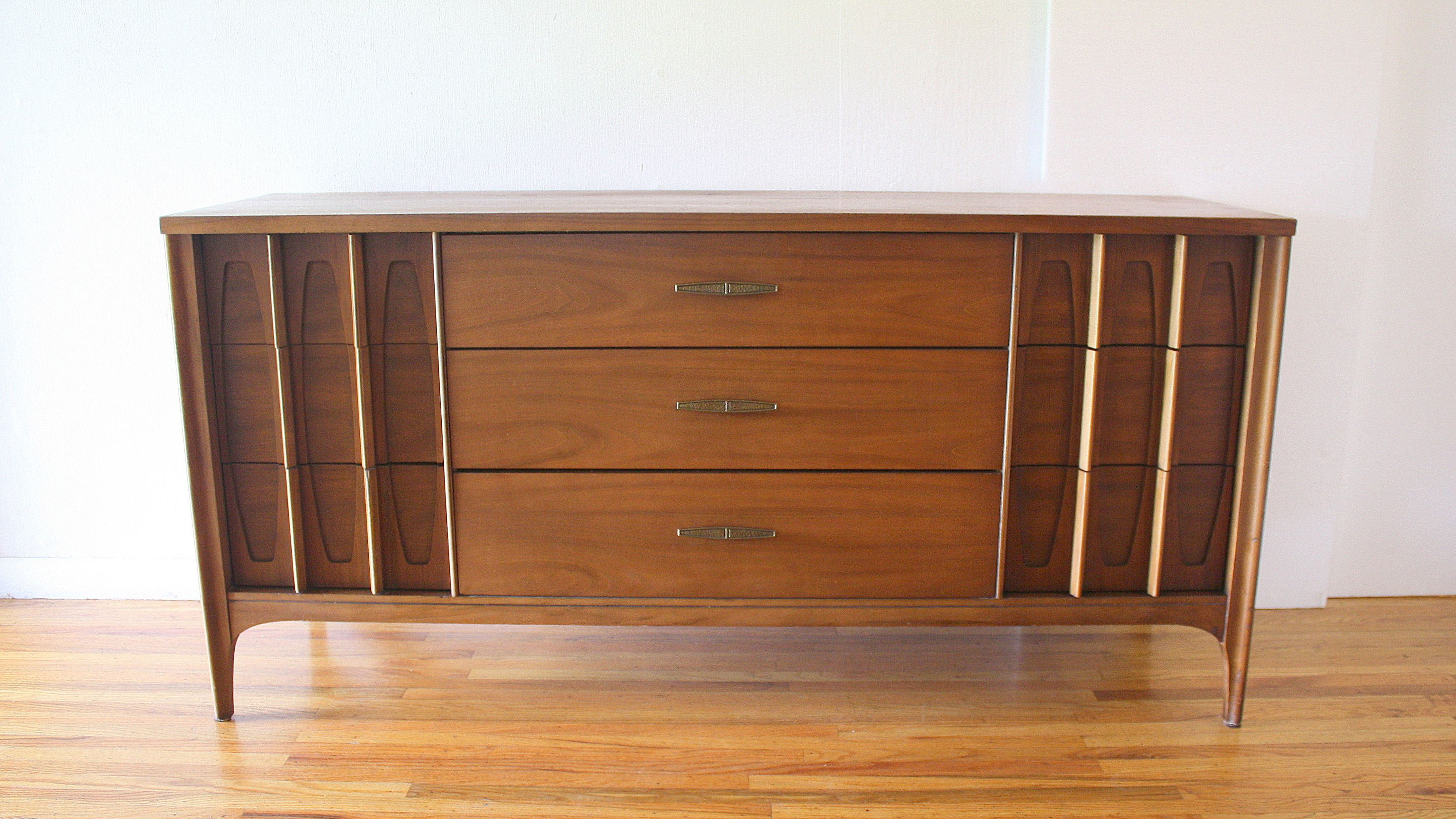 Mid Century Modern Low Dresser Credenza With A Sculpted Drawer Design Angled Br Pulls And Tapered Legs