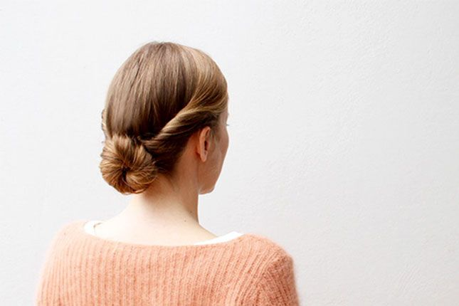 Impress everyone at your holiday party with a double twist bun hairstyle.