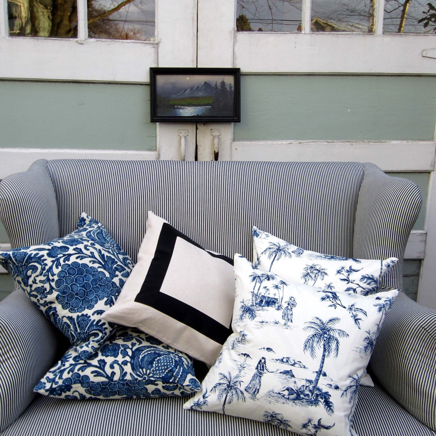 These blue batik floral pillows look nice with the black ribbon and