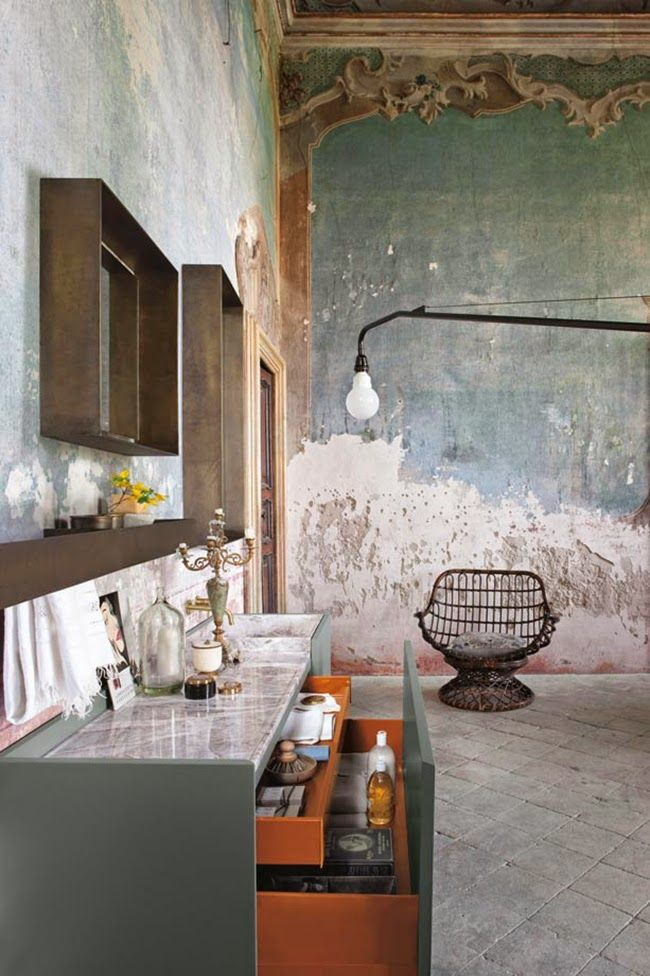 The most decadent bathroom ever. Altamarea. Rustic walls, tile floors, marble countertops, vintage furniture
