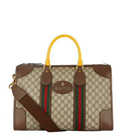 GUCCI Medium Soft Gg Supreme Webbed Duffle Bag. #gucci #bags #leather #travel bags #weekend #canvas #