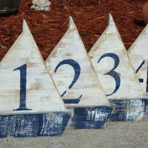Adorable Free Standing Wooden Sail Boats, Wedding Table Numbers, Nautical Beach-y Event. 10 table numbers total. Any color is available, but the one shown is navy and white on sailboats. Perfect for a nautical wedding or event. $170.00. http://aftcra.com/thesavvyshopper1/listing/4630/10-free-standing-wooden-sail-boats-wedding-table-numbers-nautical-beach-y-event