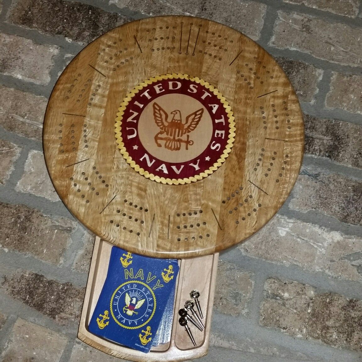 Round cribbage board with inlaid US Navy logo, designed in