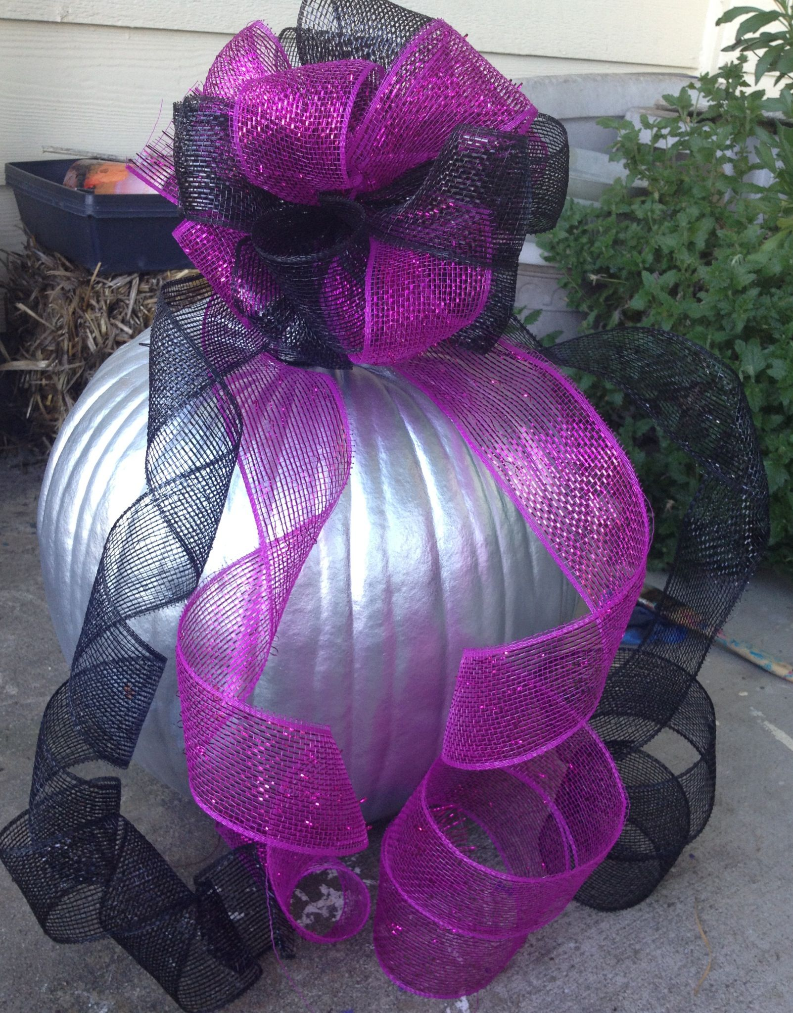 Silver pumpkin with a black and purple bow