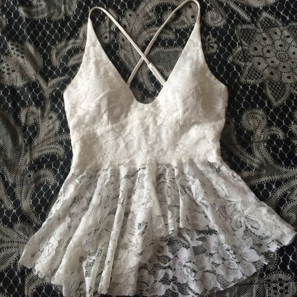 Lace tank top This is an off white lace top that has an asymmetrical cut in the front and cups so no bra is needed. Also there's a zipper in the back. Worn once. A friend bought it for me and I don't have anywhere to wear it  Lookbook store Tops Tank Tops