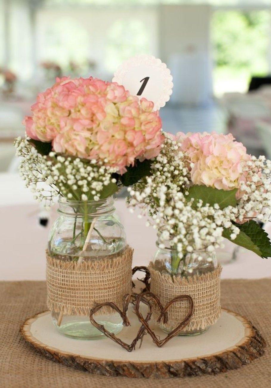 Wood plank centerpiece, babiesbreath flowers Rustic
