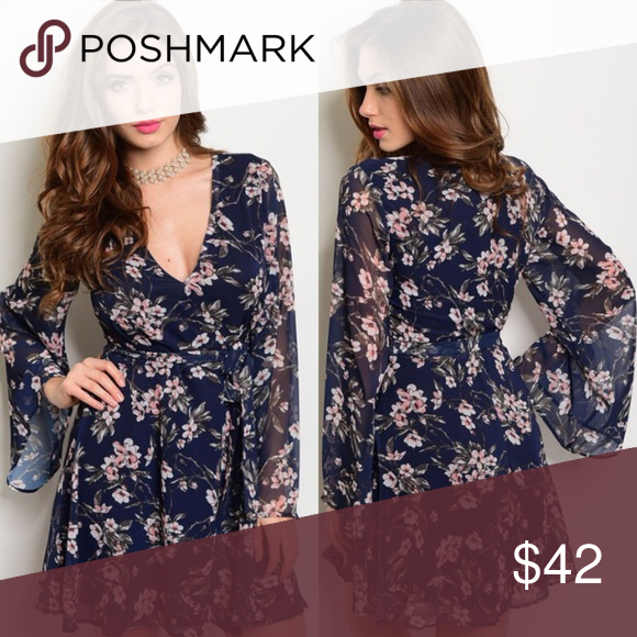 Navy Blue & Peach Floral Long Bell Sleeves Dress New with tags. Long bell sleeve, v-neck, floral mini dress perfect for Spring.                                             🌸100% polyester.                                                                   🌺PRICE IS FIRM UNLESS BUNDLED.                                    ❌SORRY, NO TRADES. Boutique Dresses Long Sleeve