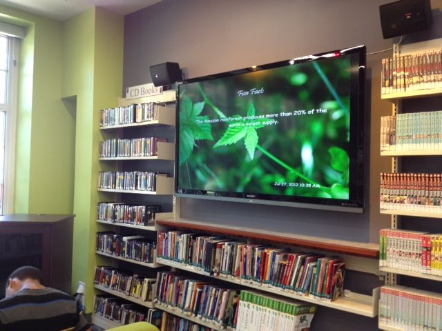 """Choose a theme for the library each month (i.e., nature, travel, Olympics, etc.). Base programs, displays, & social media posts on the theme. Put """"Fun Facts"""" involving that theme on Digital Signs."""