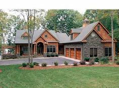 Love the stone work on the garage.  House plan featured image. Floorplans.com