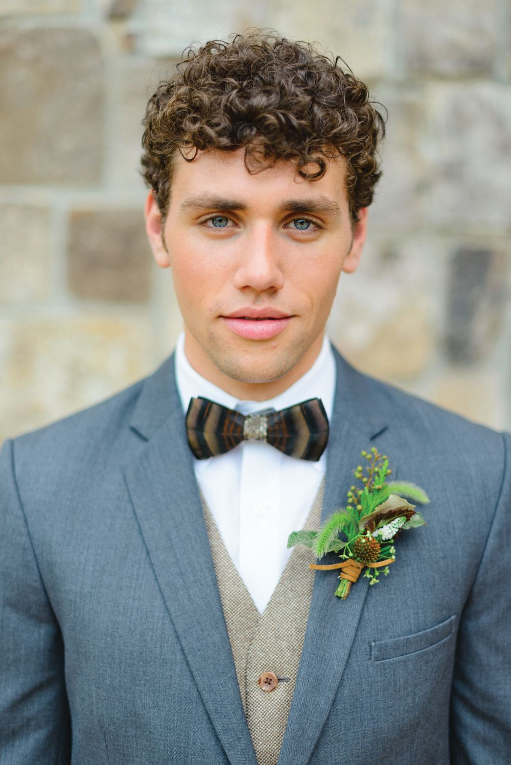 groom style steel blue suit with tweed vest feather bow tie and