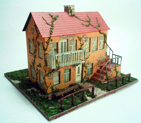 3D Paper House Print Out Paper model of a yellow house with
