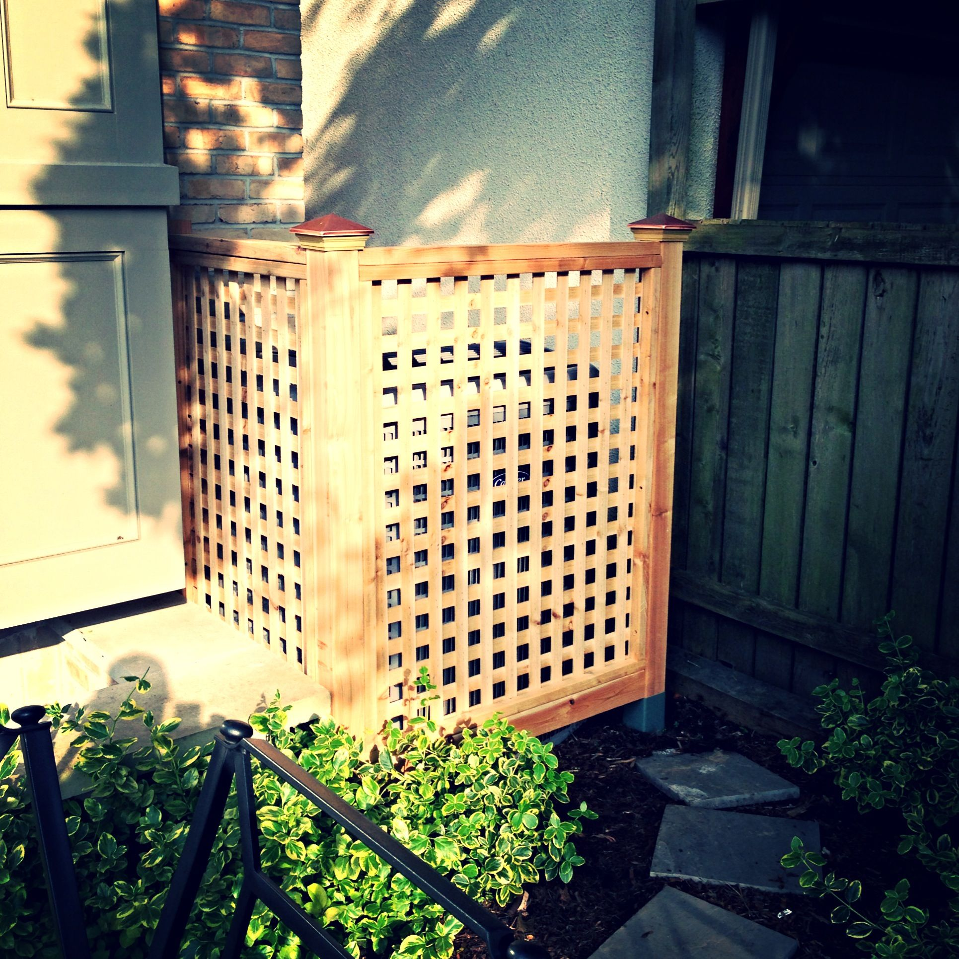 Cedar lattice air conditioner screen. Home landscaping