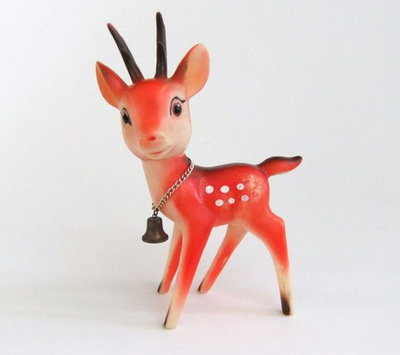 Rare vintage red rubber reindeer squeaky toy decoration with a movable head.