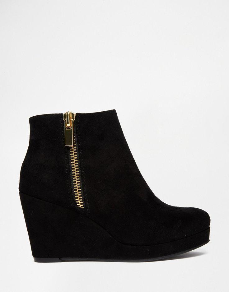 Designer shoes heels · Image 1 of River Island Black Zip Wedge Boots