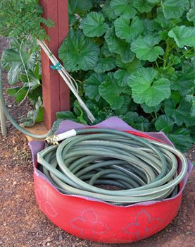 Here Are Some Crafty Things To Make Utilizing Old Tires. Here An Old Tire  Makes For A Great Place To Store The Garden Hose.