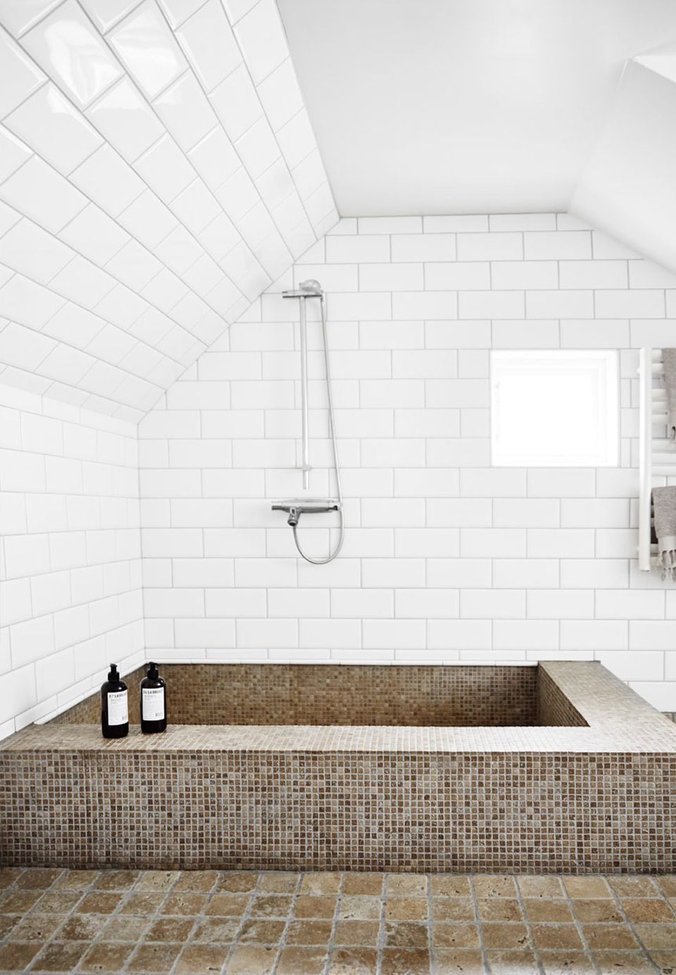Bright, simple and luxurious bathroom with white tiles and mosaics ...