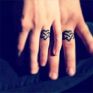 ring finger tattoos Wedding Ring Tattoos for Allergic Person