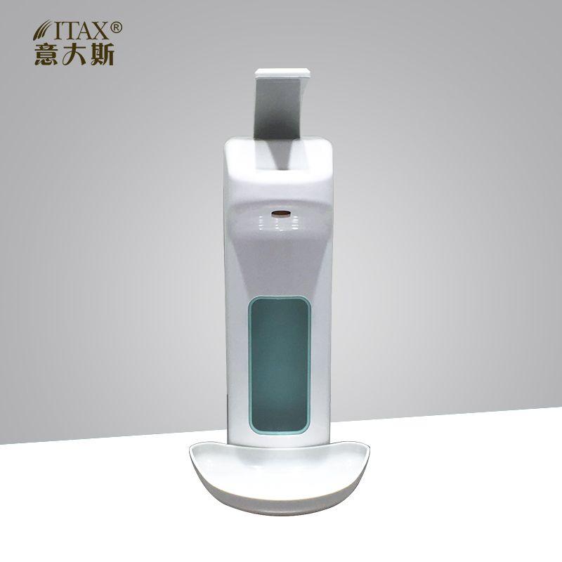 Female Medical Staff Using A Hand Sanitizer Dispenser Stock