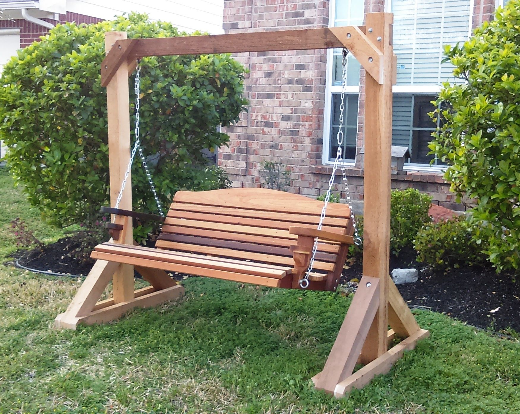 Design of covered free standing fabulous porch swing photo for Building a wooden swing