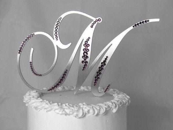 Silver monogram wedding cake topper