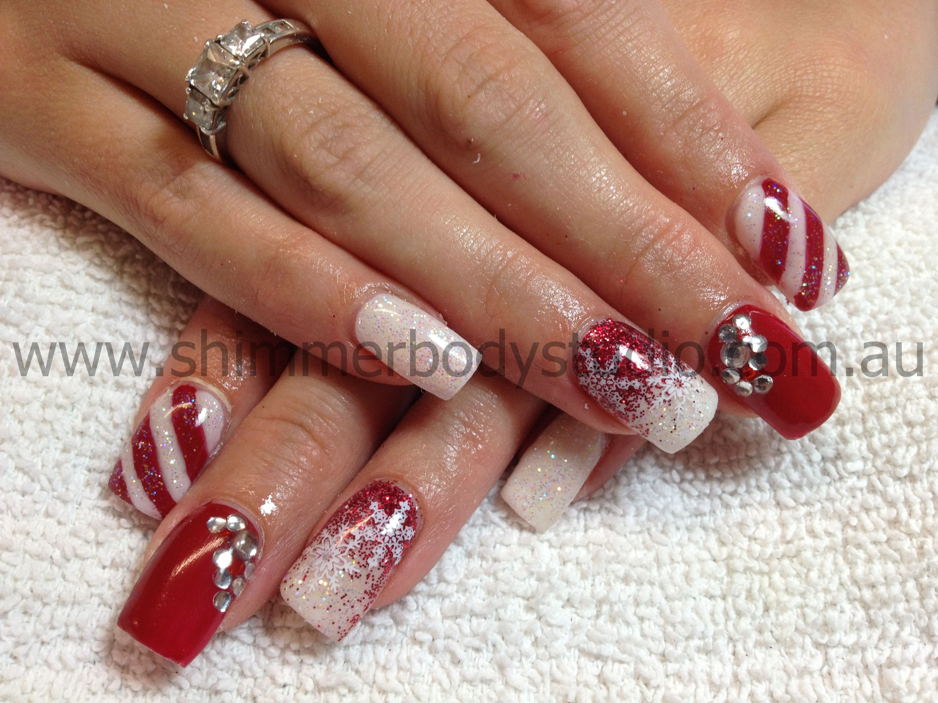 Gel nails, Christmas nails, red an white nails, glitter nails, crystals nail art by Shimmer Body Studio