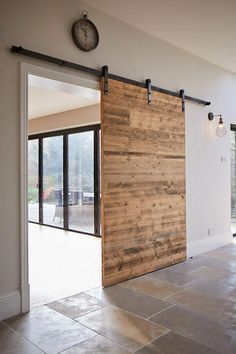 Photo of We love this sliding wooden door that can open up to make an open-plan room – we …